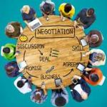 Arial view of group of people sitting around a round table