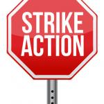 "Stop sign with words ""Strike Action"""