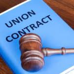 Copy of union contract booklet with gavel laying on top